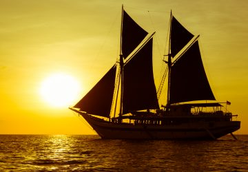 komodo travel ship during sunset